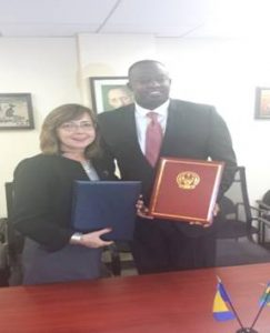 Signing Ceremony at the Permanent Mission of Bosnia and Herzegovina to the United Nations in New York; H.E.Mr. Eugène-Richard Gasana and H.E. Ms. Mirsada Čolaković